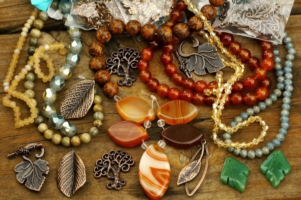 A variety of necklaces and charms using marble stones, large and small colored beads, and leaf-shaped charms