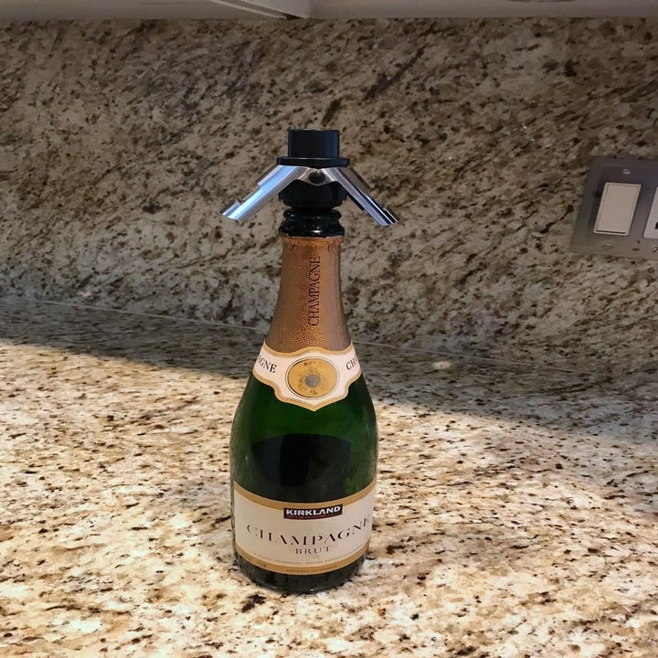 reviewer's bottle of bubbly with the stopper partway in