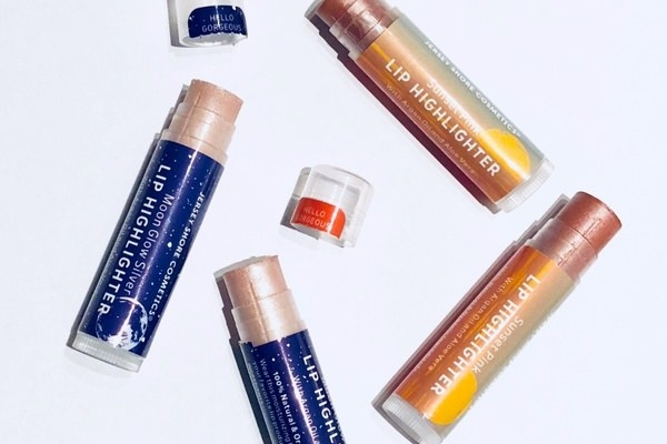 four lip balms with the caps off