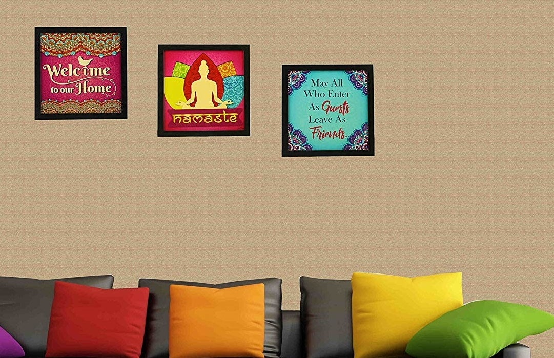 """Framed art prints reading """"Welcome to our home,"""" """"Namaste,"""" and """"May all who enter as guests leave as friends."""""""