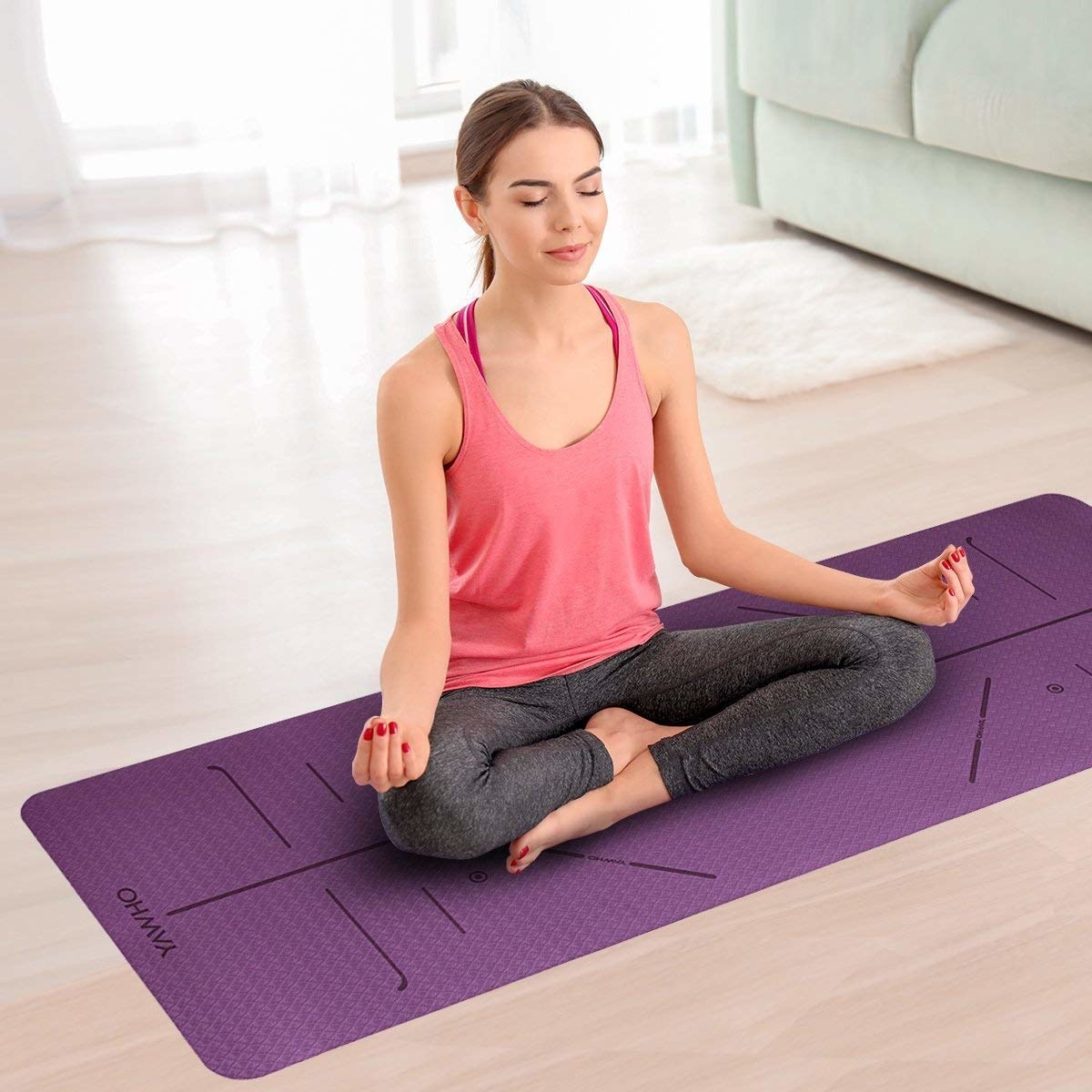 A person finding their zen on the yoga mat