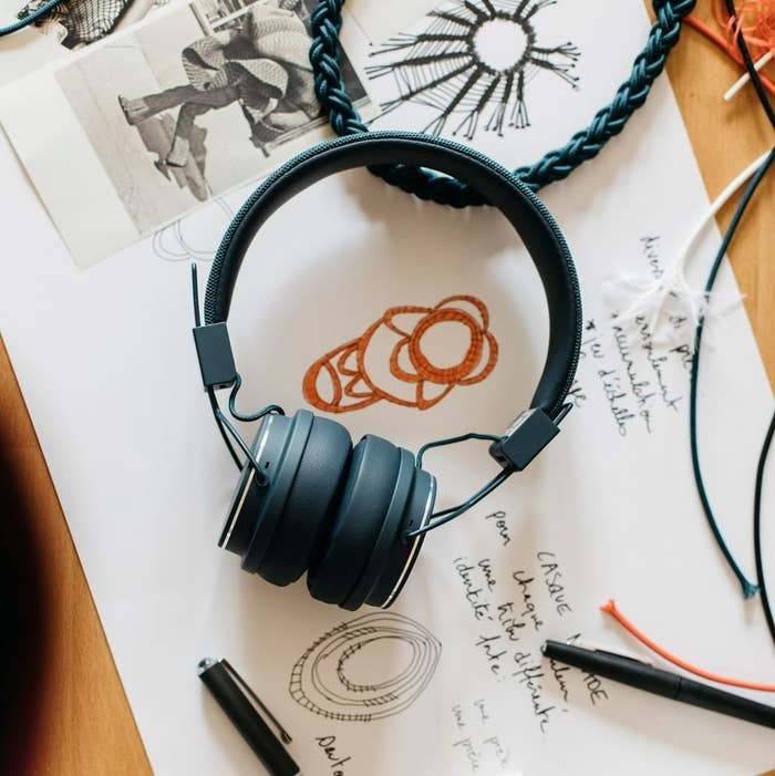 A pair of headphones lying on a desk