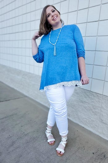 reviewer wearing the top in blue with white trim