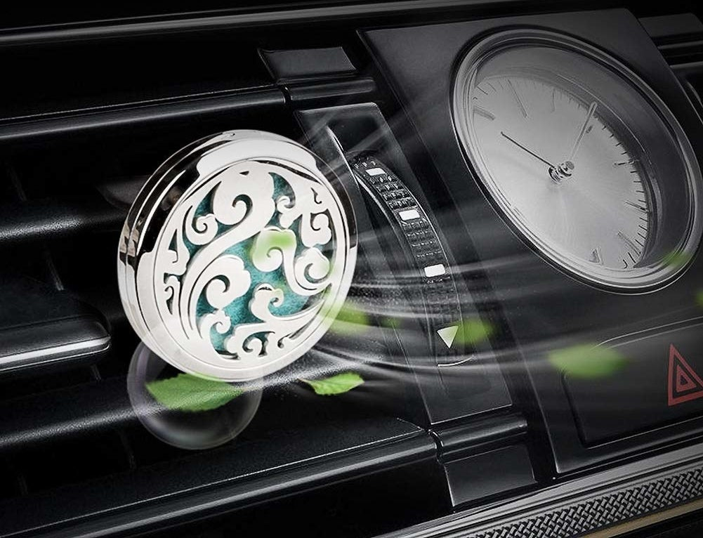 The essential oil diffuser attached to a vent in a car