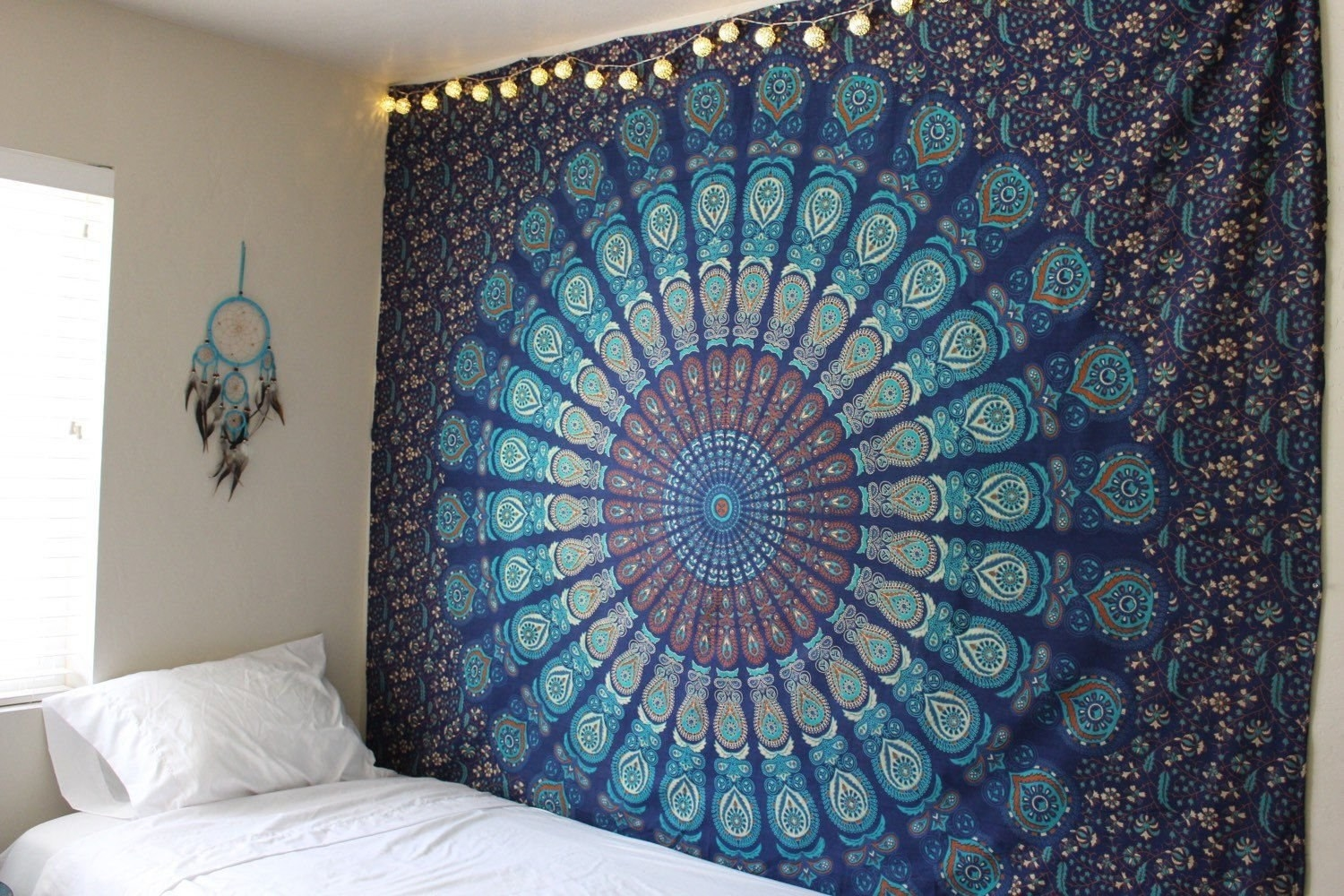 Tapestry hanging in a room beside a bed.