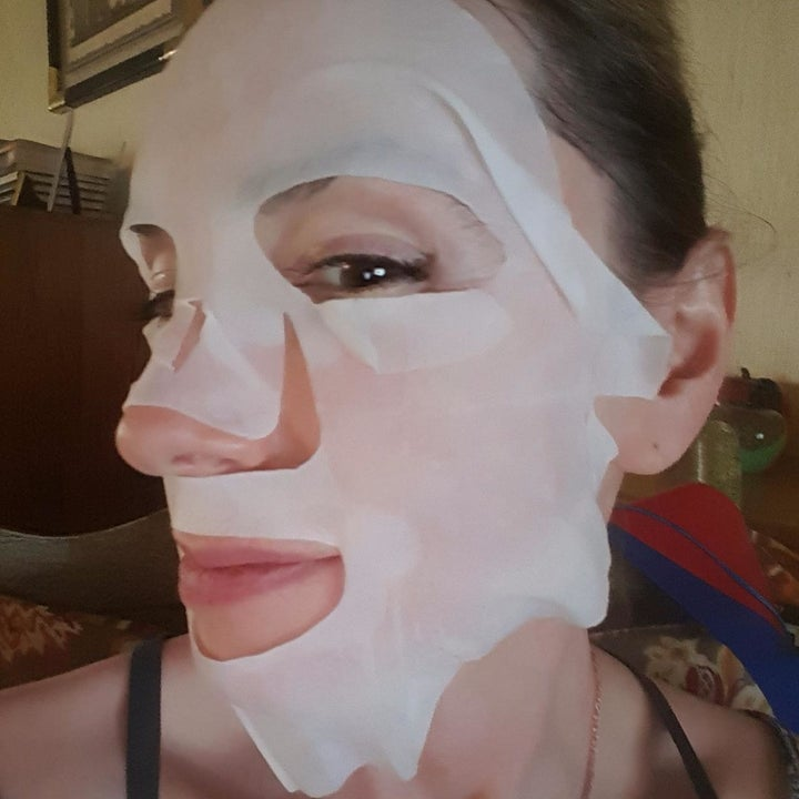 reviewer with a white face mask on