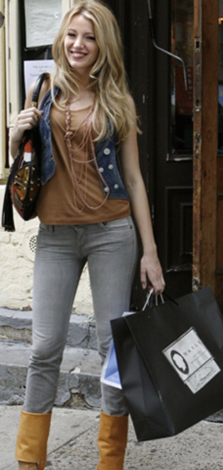 Jeans with high boots, gray jeans, layered necklaces, a denim crop vest, and a loose tank