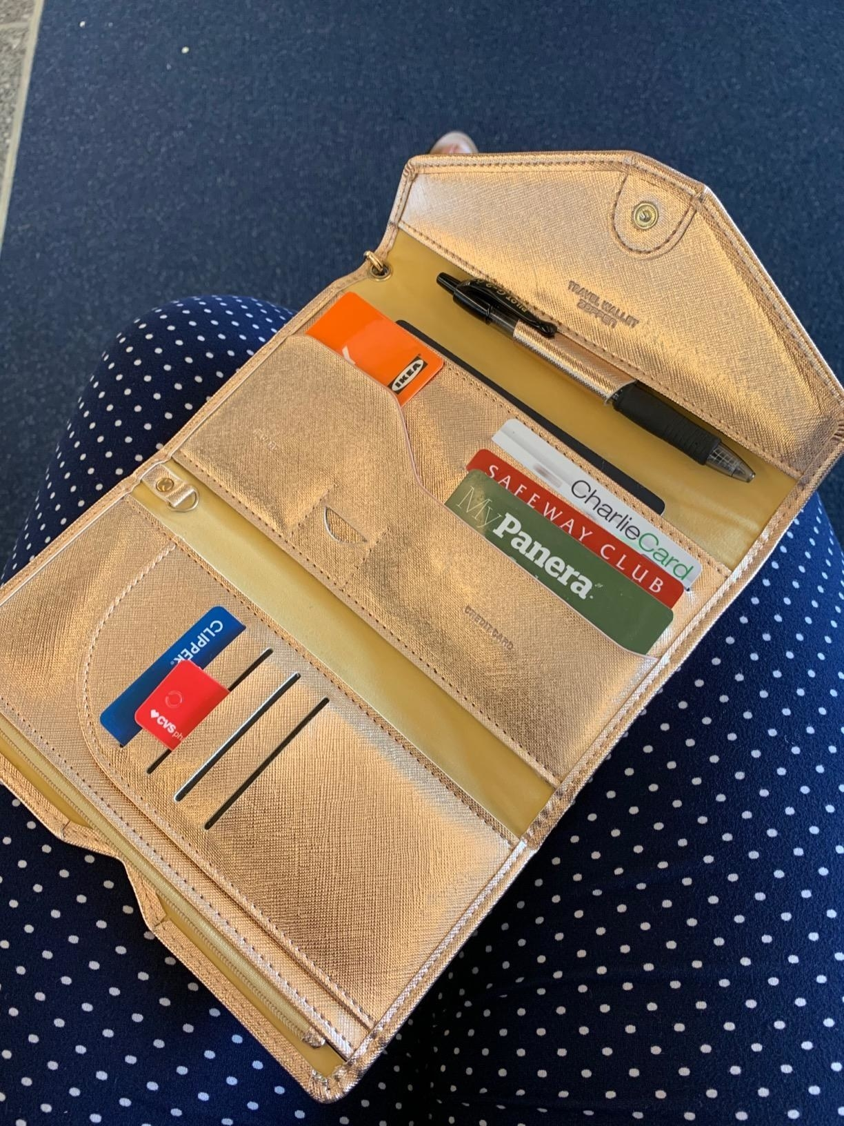 reviewer photo showing their RFID wallet neatly organized with their cards and cash