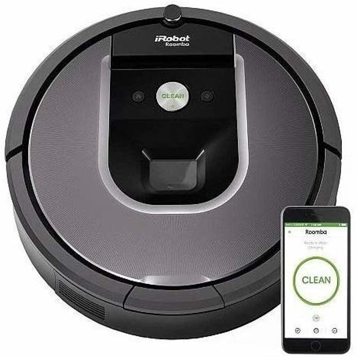 the irobot roomba next to a smartphone with the app on the screen