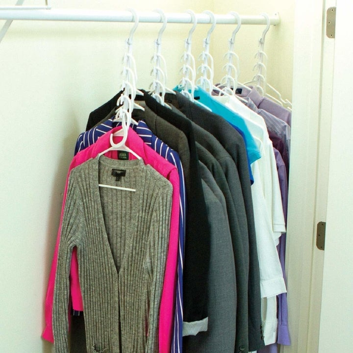 the wonder hangers being used to hang clothes vertically