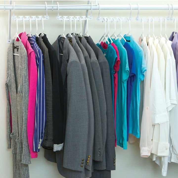 the wonder hangers being used to hang clothes horizontally