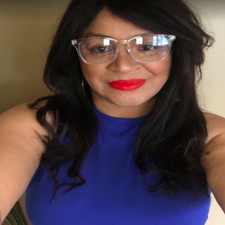 a reviewer wearing the clear frame blue-light blocking glasses