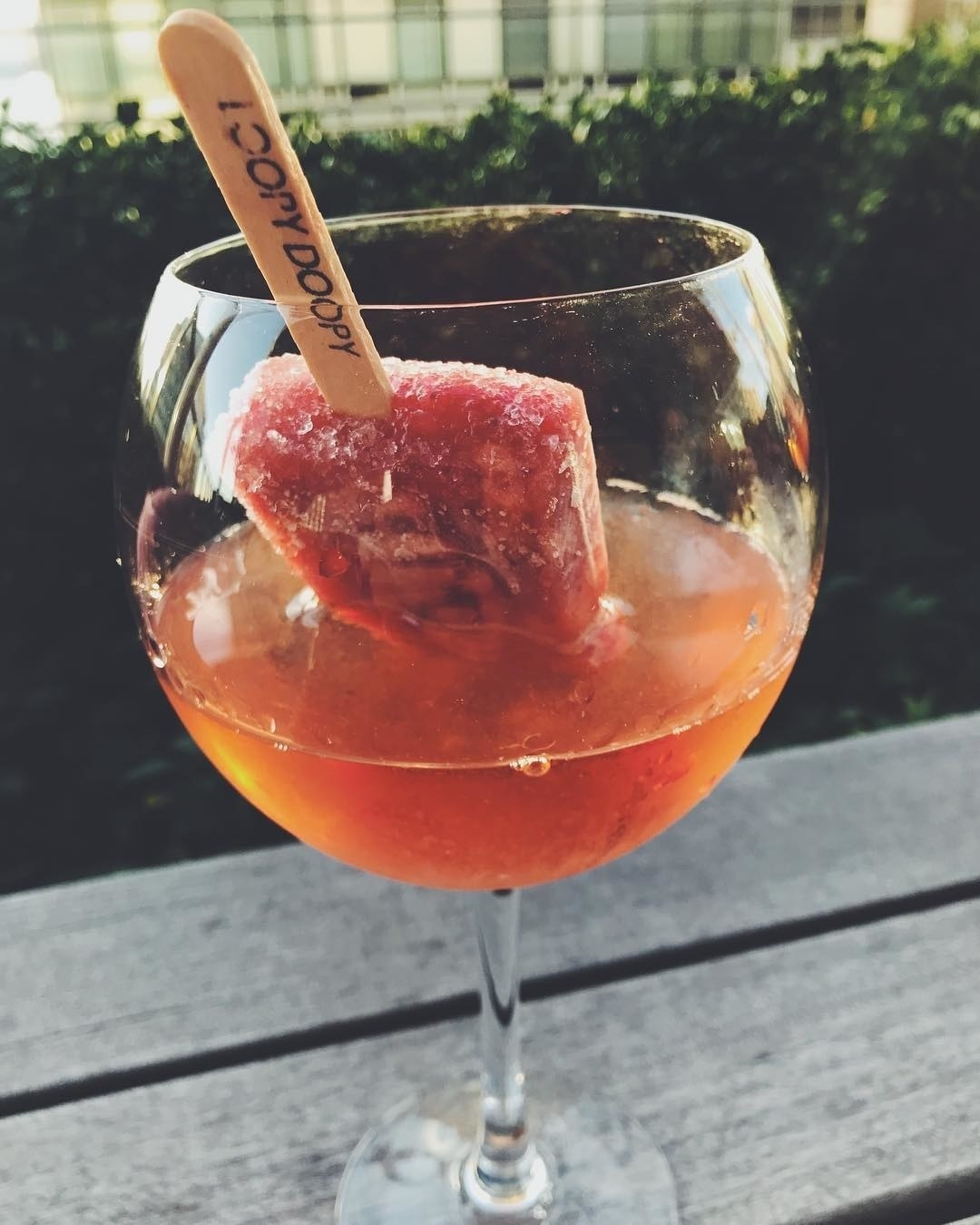 a popsicle in a glass of Prosecco