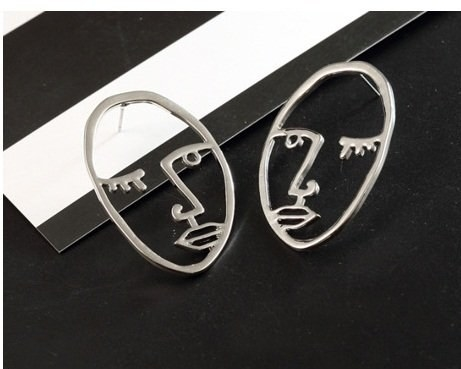 Earrings shaped like abstract faces.