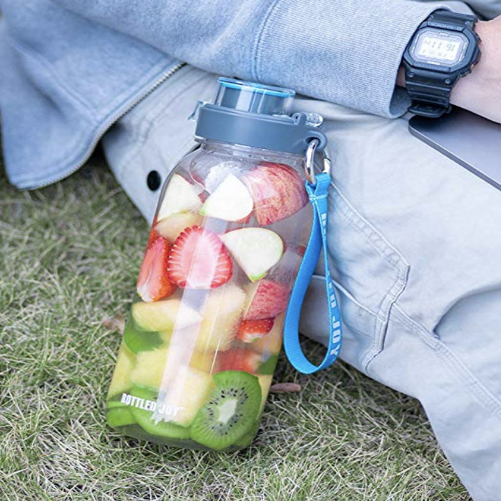 the water bottle filled with fresh fruit and water