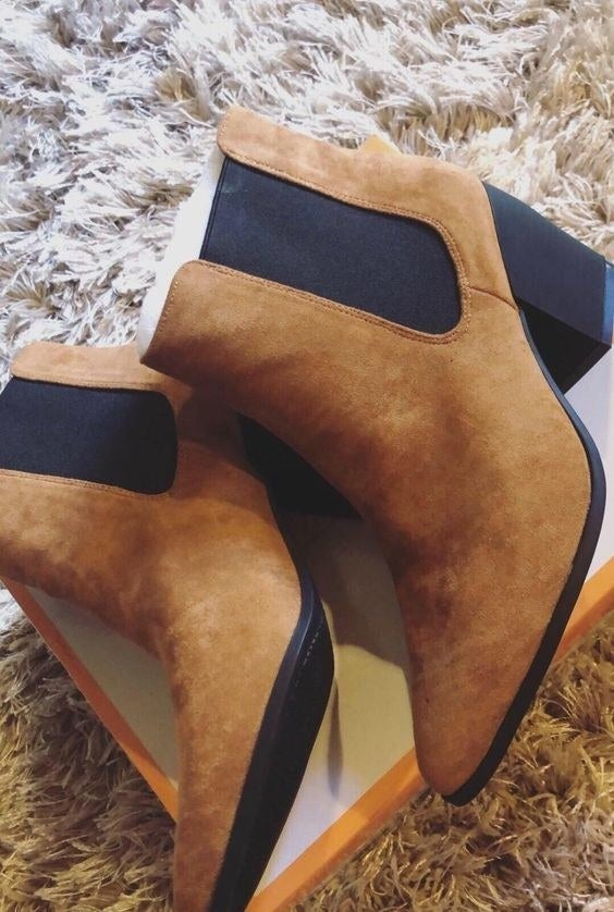 Reviewer's picture of the brown suede booties