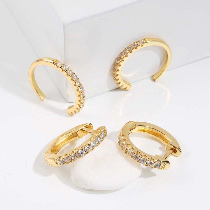 various gold earring cuffs