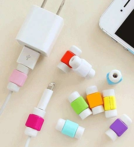 Apple phone charging wires with multicoloured cable protectors installed on them