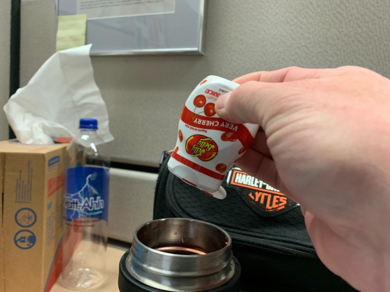 hand drips jelly bean goo into bottle