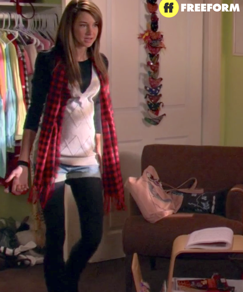 Deep V sweatervest with a long plaid scarf, jean shorts, and tights
