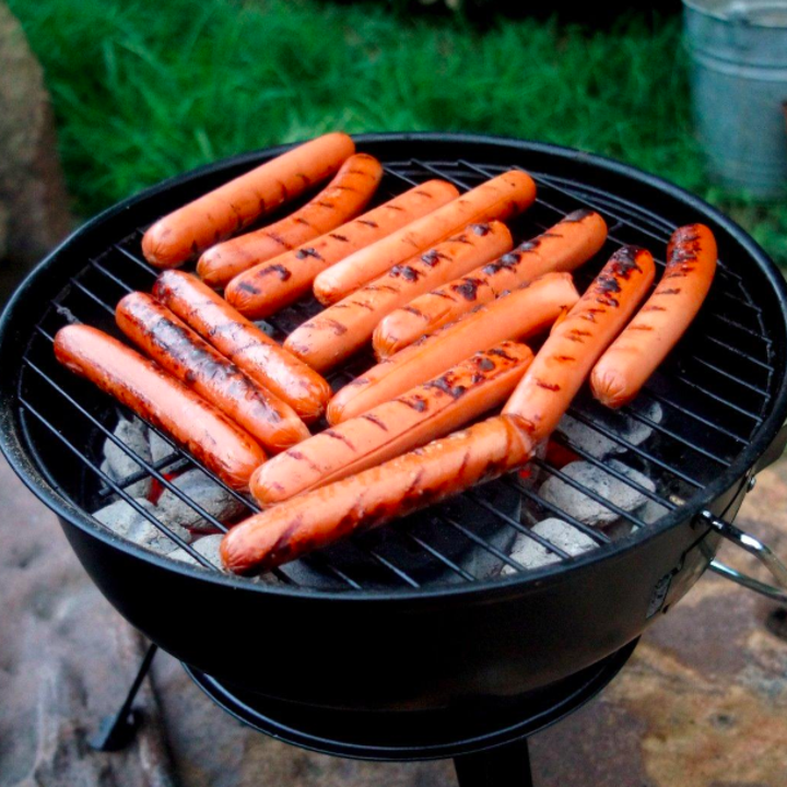 grilled hot dogs made on a grill lit with the insta fire