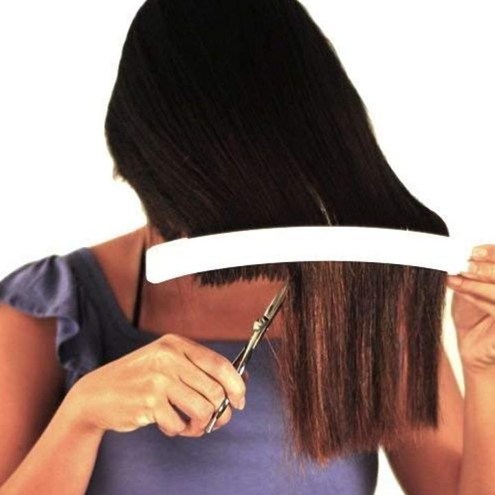 person cutting their own hair using creaclip