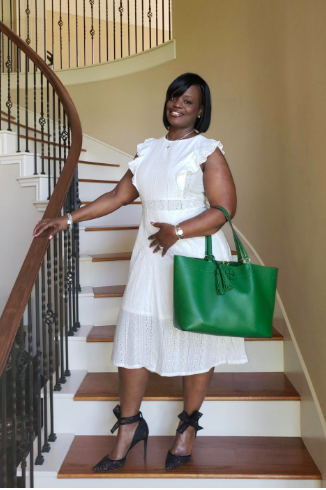 A reviewer wearing the eyelet cap sleeve midi in white