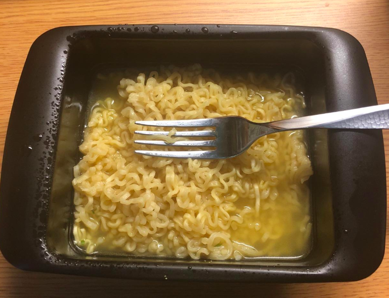 reviewer eating ramen out of the cooker