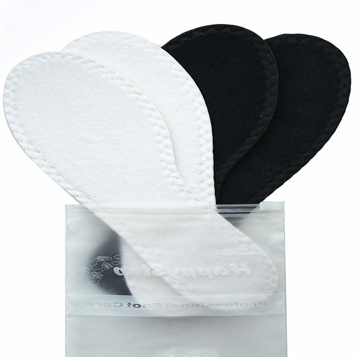 two pairs of insoles, one white and one black