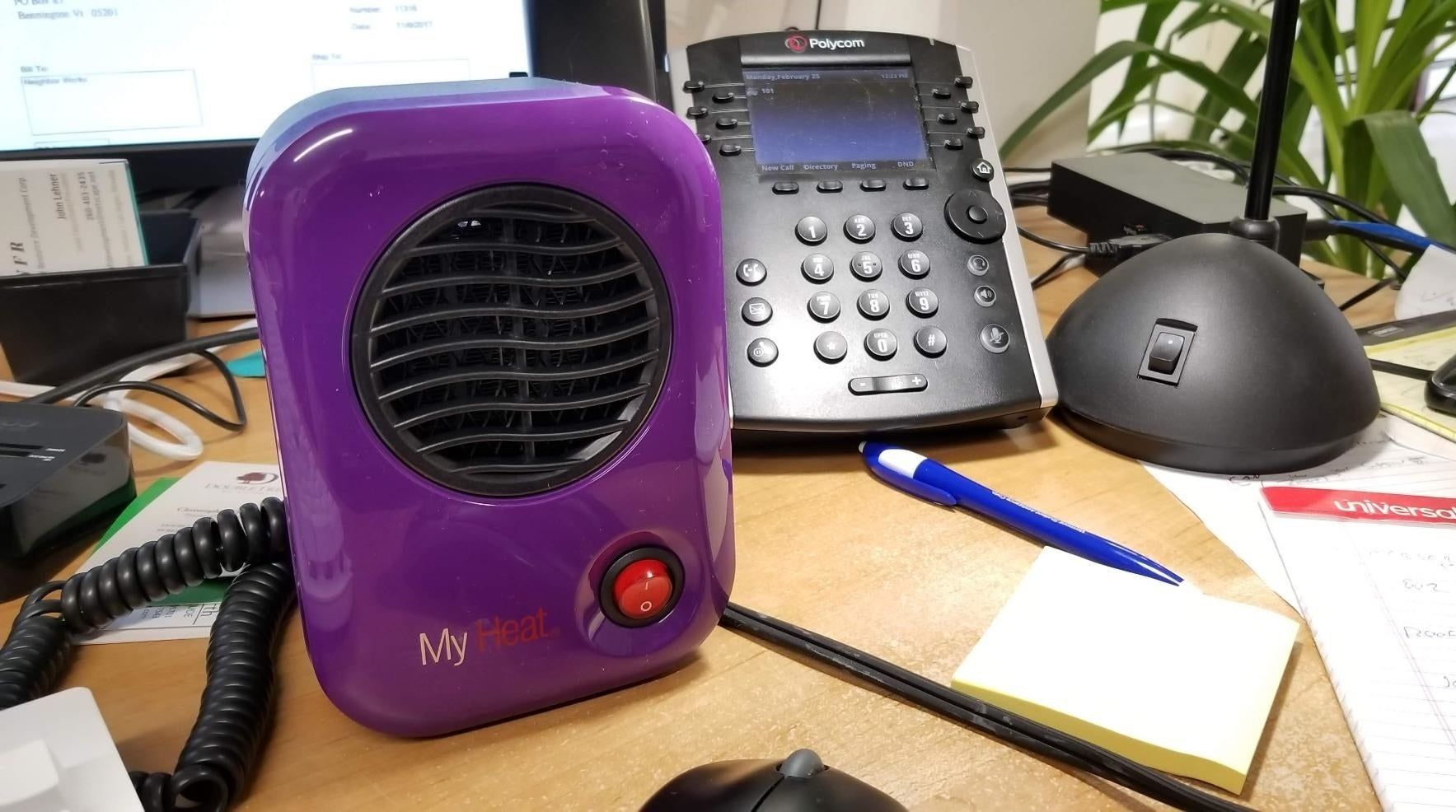 Reviewer photo of mini purple space heater placed on desk