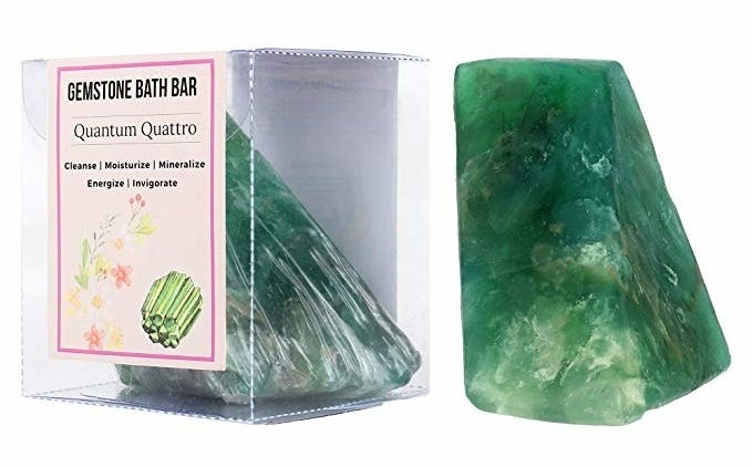 A green gemstone bath soap bar inside and outside its box