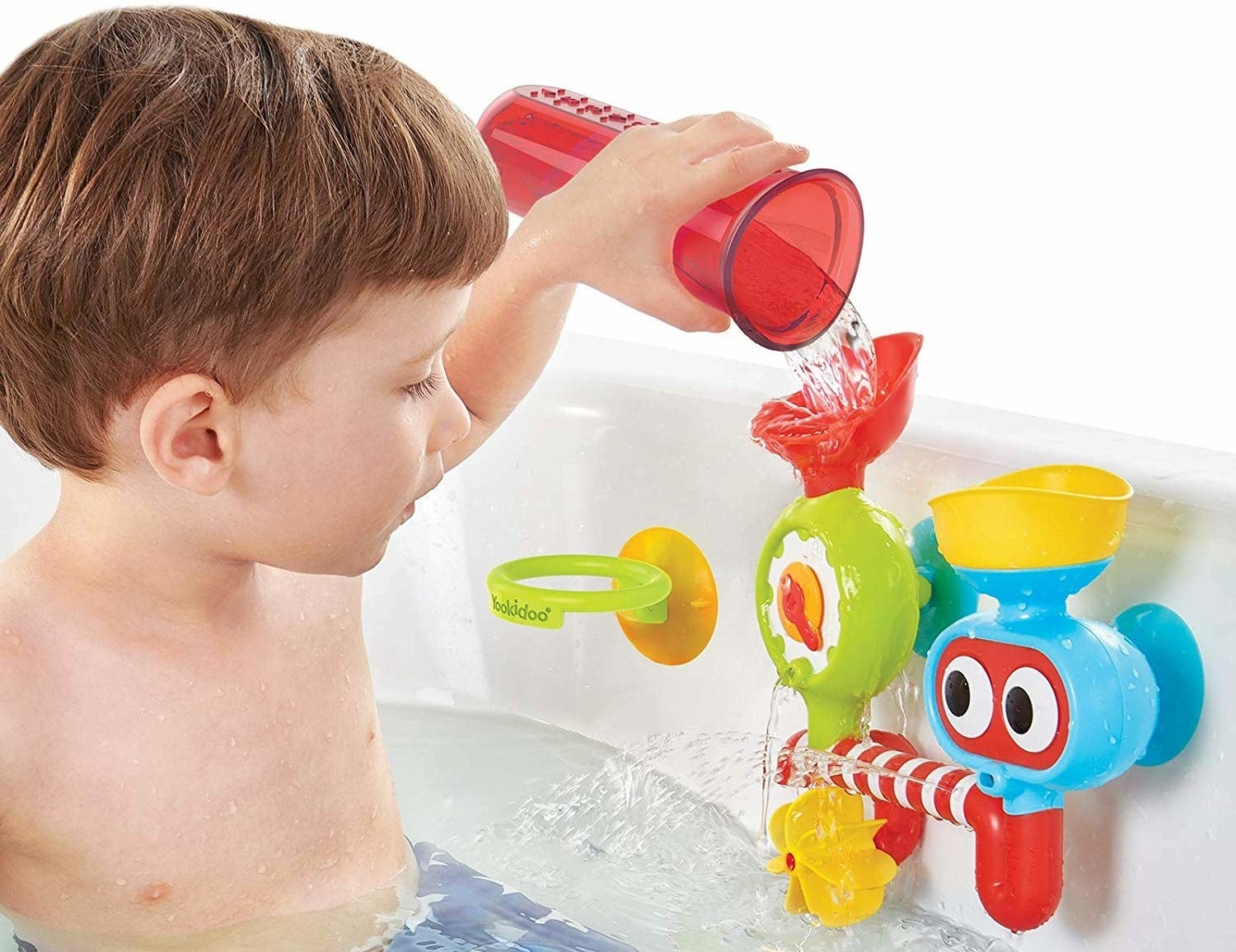 A child model in a tub pouring water into a multi-colored water lab