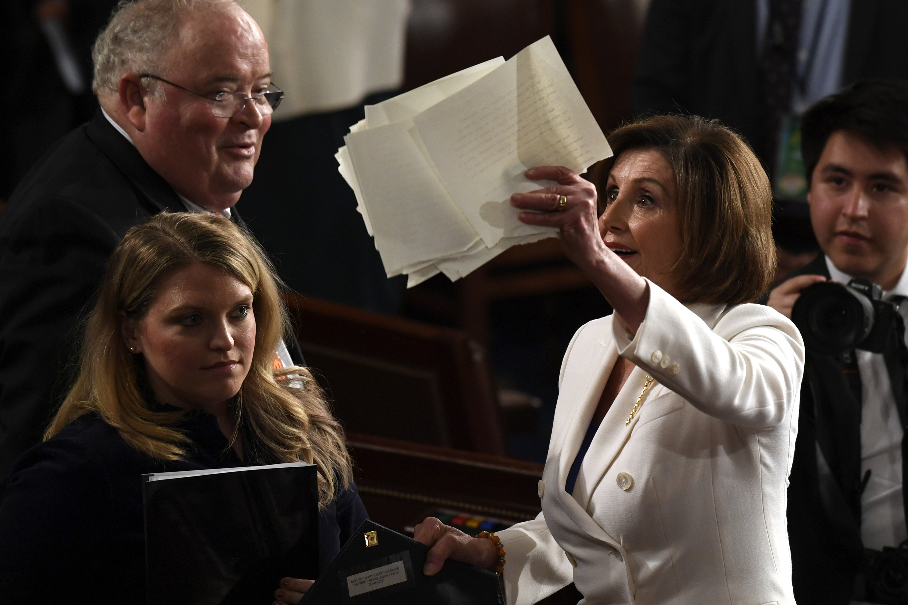 House Speaker Nancy Pelosi holds up a copy of President Donald Trump's State of the Union address to a joint session of Congress that she tore up.