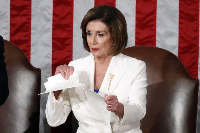 House Speaker Nancy Pelosi tears her copy of President Donald Trump's State of the Union address.