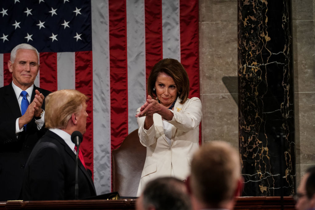 Speaker Nancy Pelosi and Vice President Mike Pence applaud U.S. President Donald Trump at the State of the Union address in the chamber of the U.S. House of Representatives at the U.S. Capitol Building on February 5, 2019