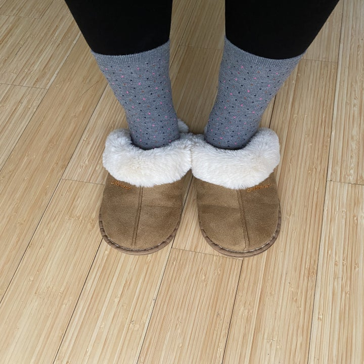 Feet in the tan slippers with sherpa lining