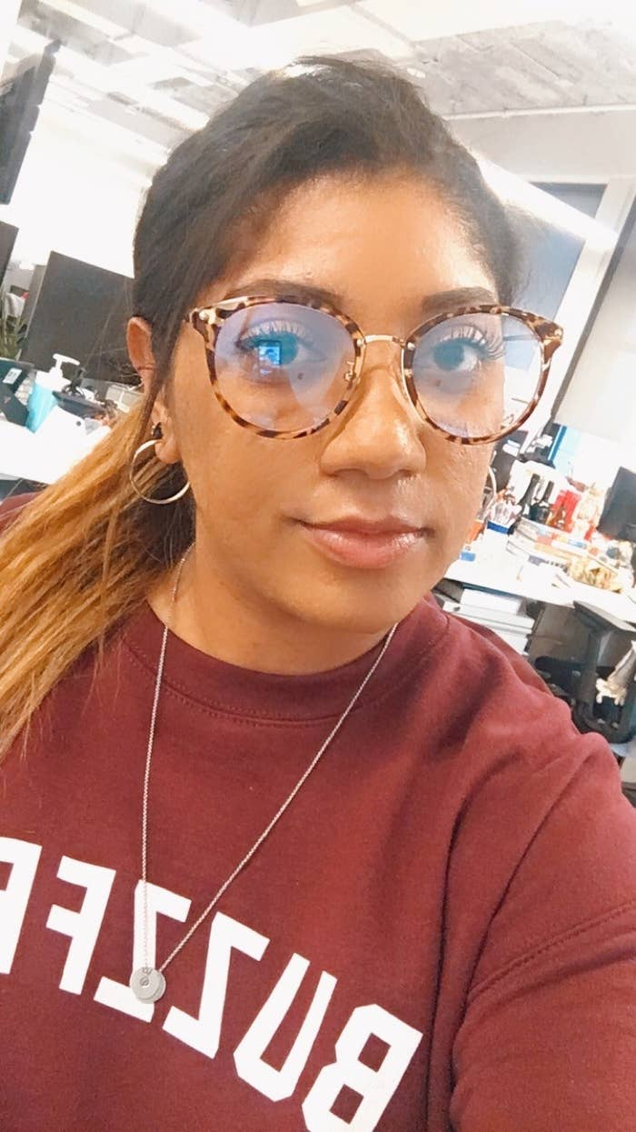 A person wearing the blue light glasses in their office