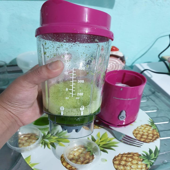 The top popped off the blender to become a cup full of smoothie after it's been mixed