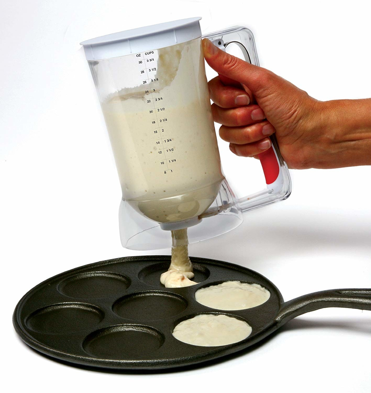 A model using the pancake dispenser to load pancake mix onto a pan