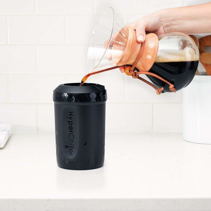 model pouring coffee into black hyperchiller bottle