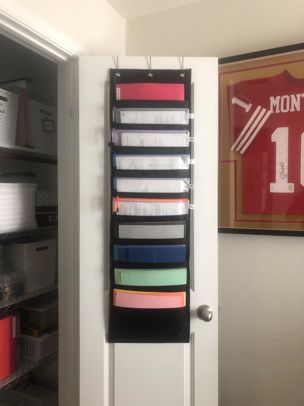 Reviewer photo of the 10-slot organizer hanging from the back of a closet door