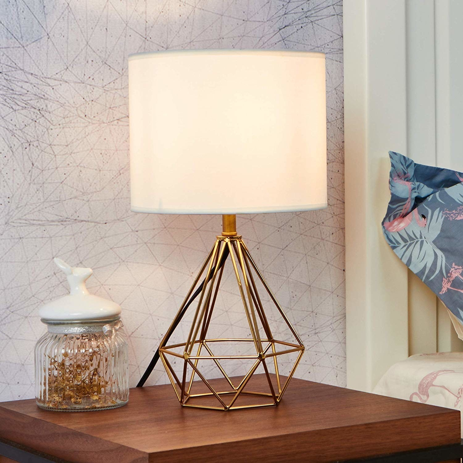 Table lamp with a gold diamond-shaped wire base and white shade