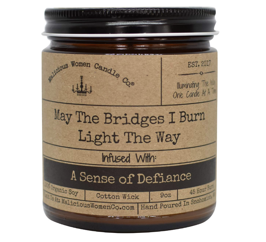 candle called may the bridges I burn light the way infused with a sense of defiance