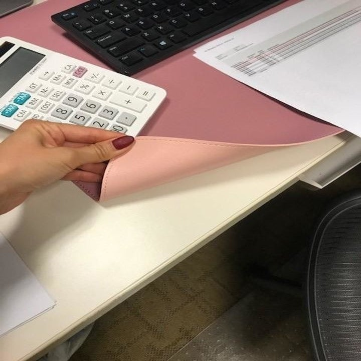 reviewer image of reversible pink/purple desk mat