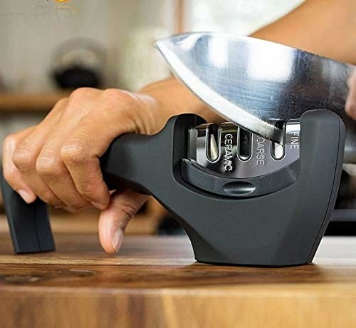 A knife being sharpened using the gadget