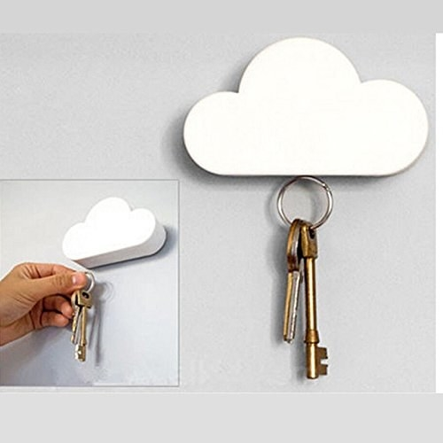 Keys being hung on the cloud-shaped key holder that's installed on a wall