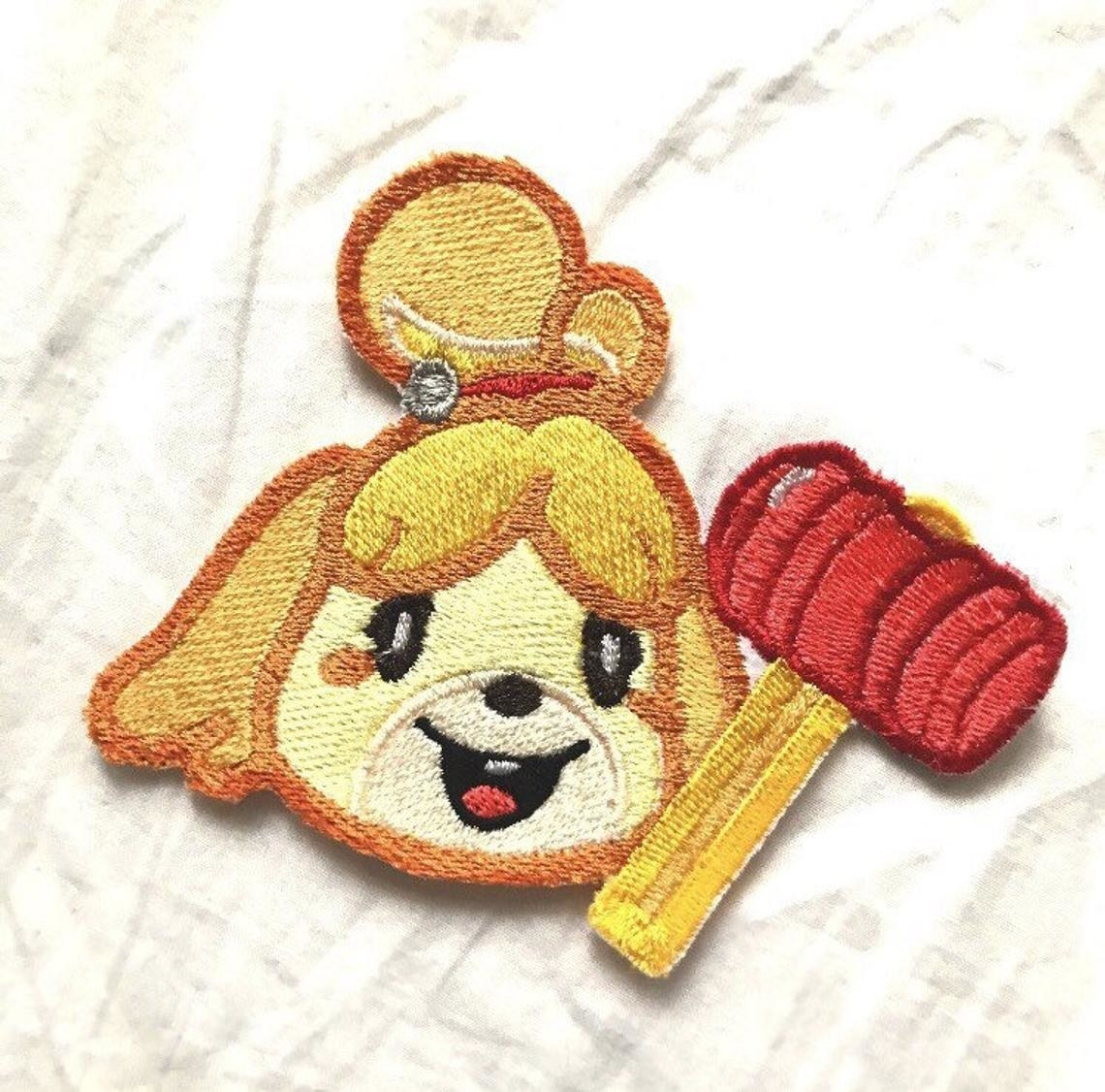 isabelle's head with her red mallet from super smash brothers ultimate