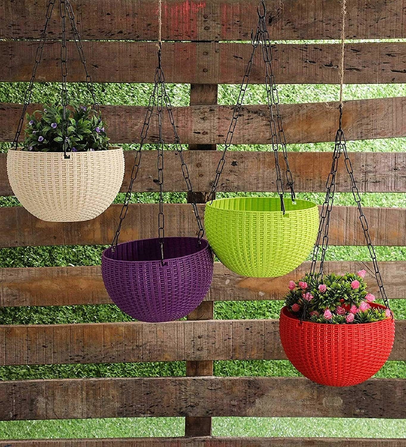 Hanging baskets in front of a wall of wooden blocks.