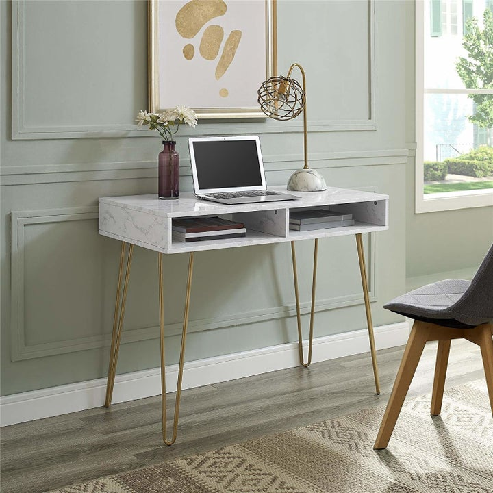 the desk with a laptop on it