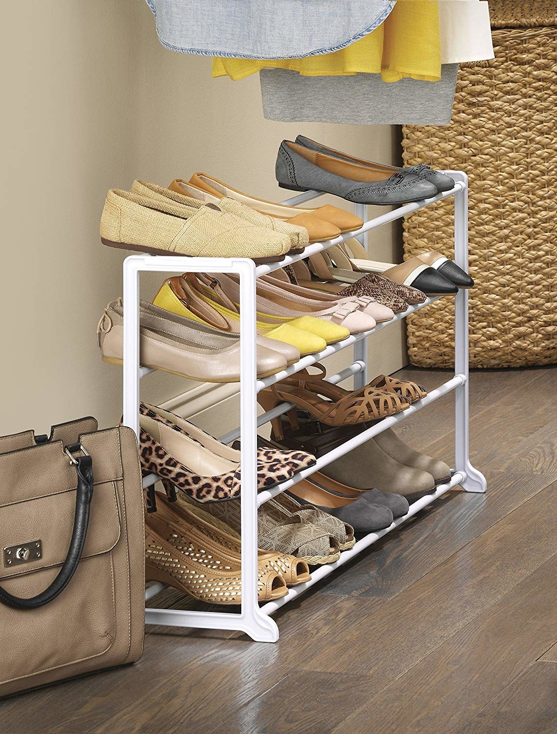 white plastic rack organizing heels, flats, and sneakers in a closet
